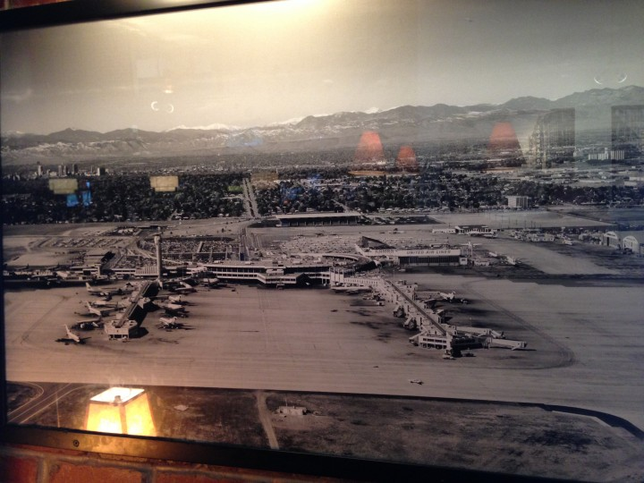 Framed photo of the old Stapleton Airport with Downtown Denver in the background, now hanging in a Northfield restaurant.