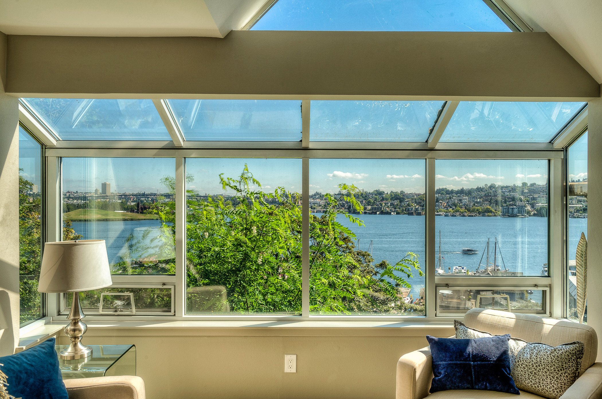 Terrific 180 degree views of Lake Union from this sizable 2 bedroom, 2 bath, end unit condo on East Queen Anne! The updated kitchen has beautiful new granite counters and stainless appliances. Private patio with fantastic views of the Lake & Gas Works Park. Master suite with 5 piece bath, walk in closet, patio slider & lake views. The 2nd bedroom has a murphy bed for den/bedroom flexibility. New carpets, gas fireplace, vaulted ceilings in the living room & 2 parking spaces in the secure garage!