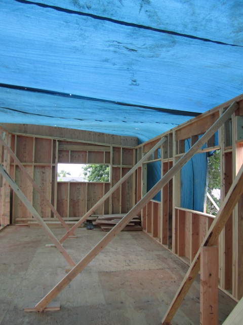 tarp over framed walls