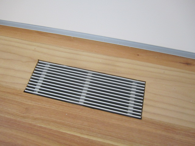 supply grille in wood flooring