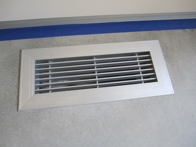 supply grille in concrete flooring