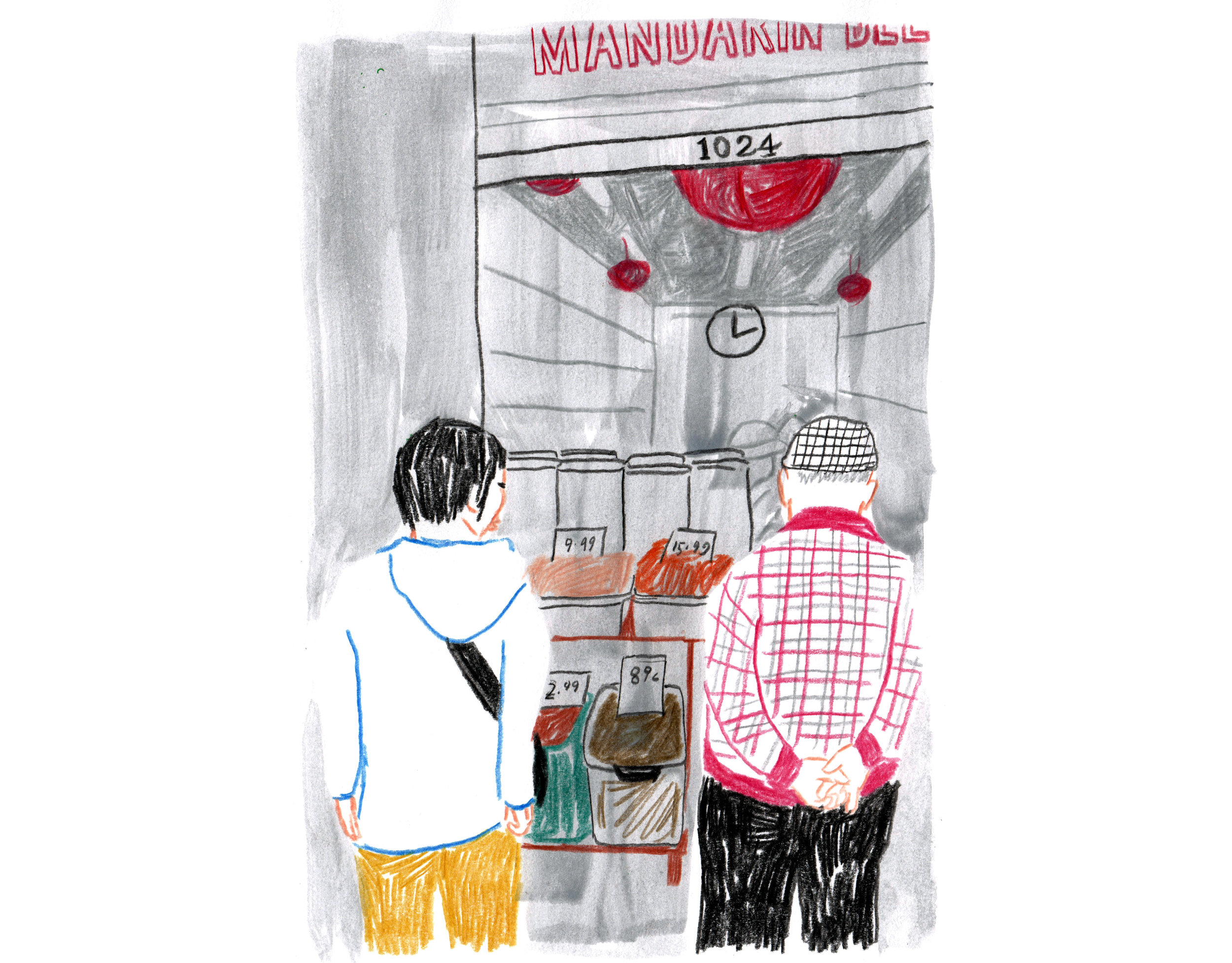 Couple looking at produce outside a shop in San Francisco's Chinatown.