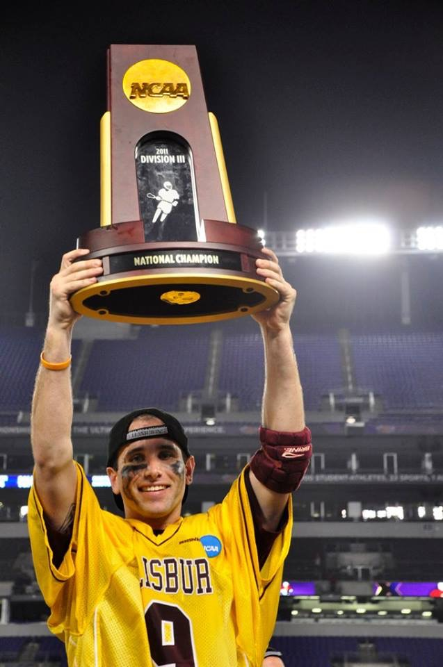 TTL Perry Craz NCAA trophy hoist photo.JPG