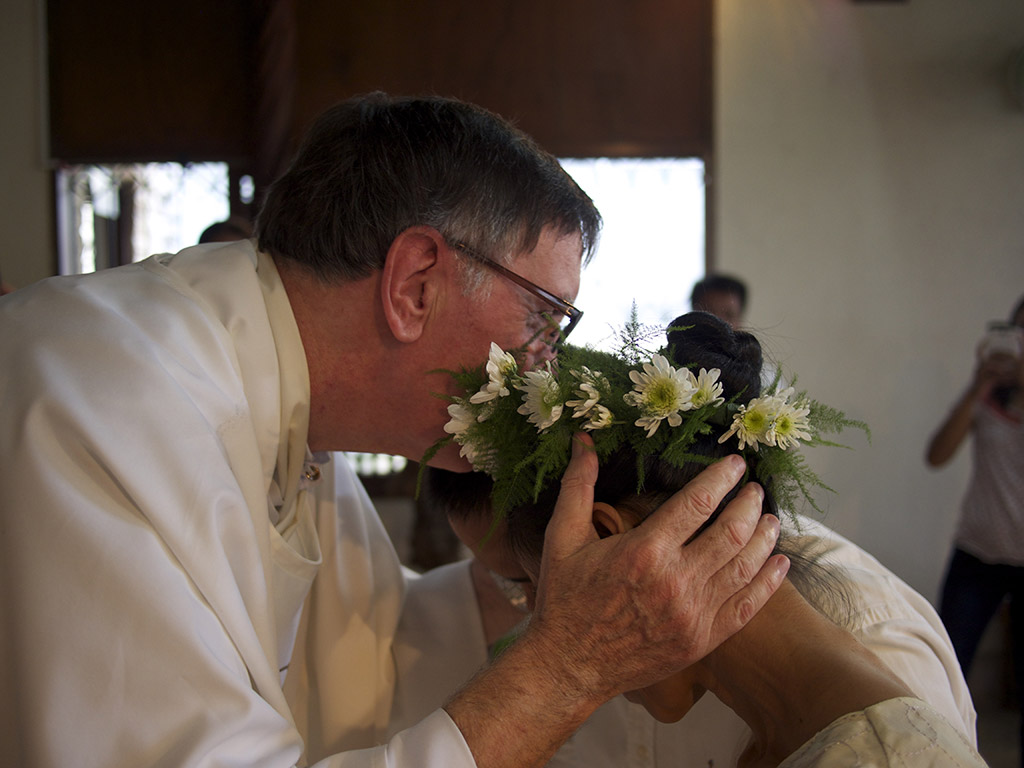 Volunteer Chaplain blessing the newlyweds