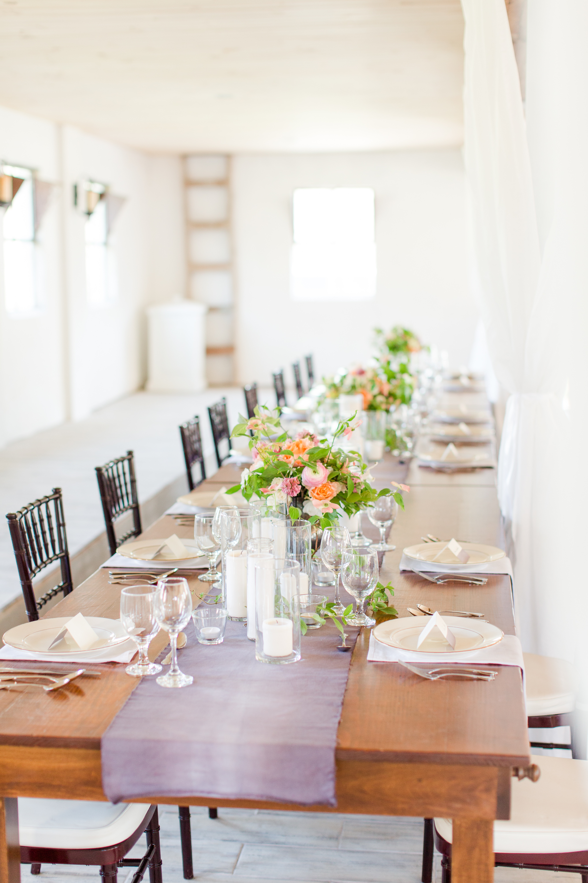 Genevieve used cylinder vases and candles to create an enchanting setting