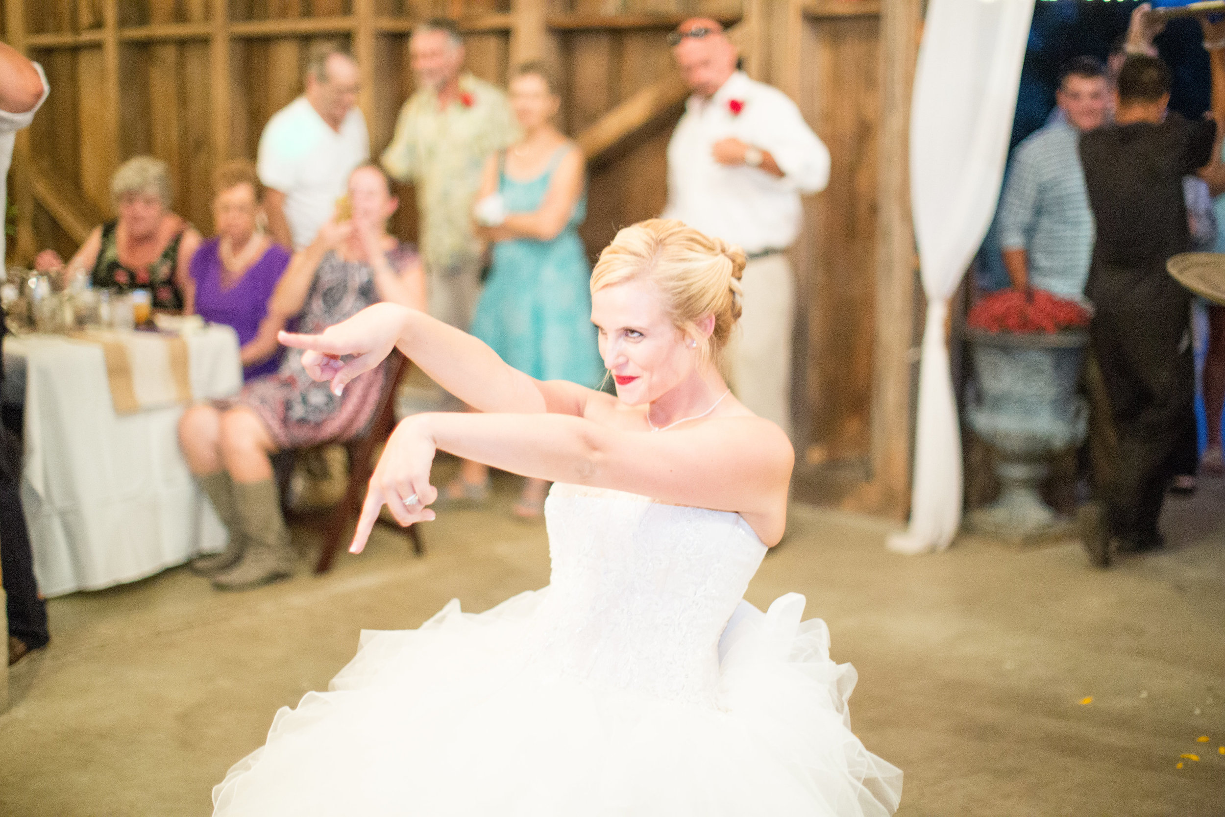 bride-garter-toss-country-rustic-wedding-photos.jpg