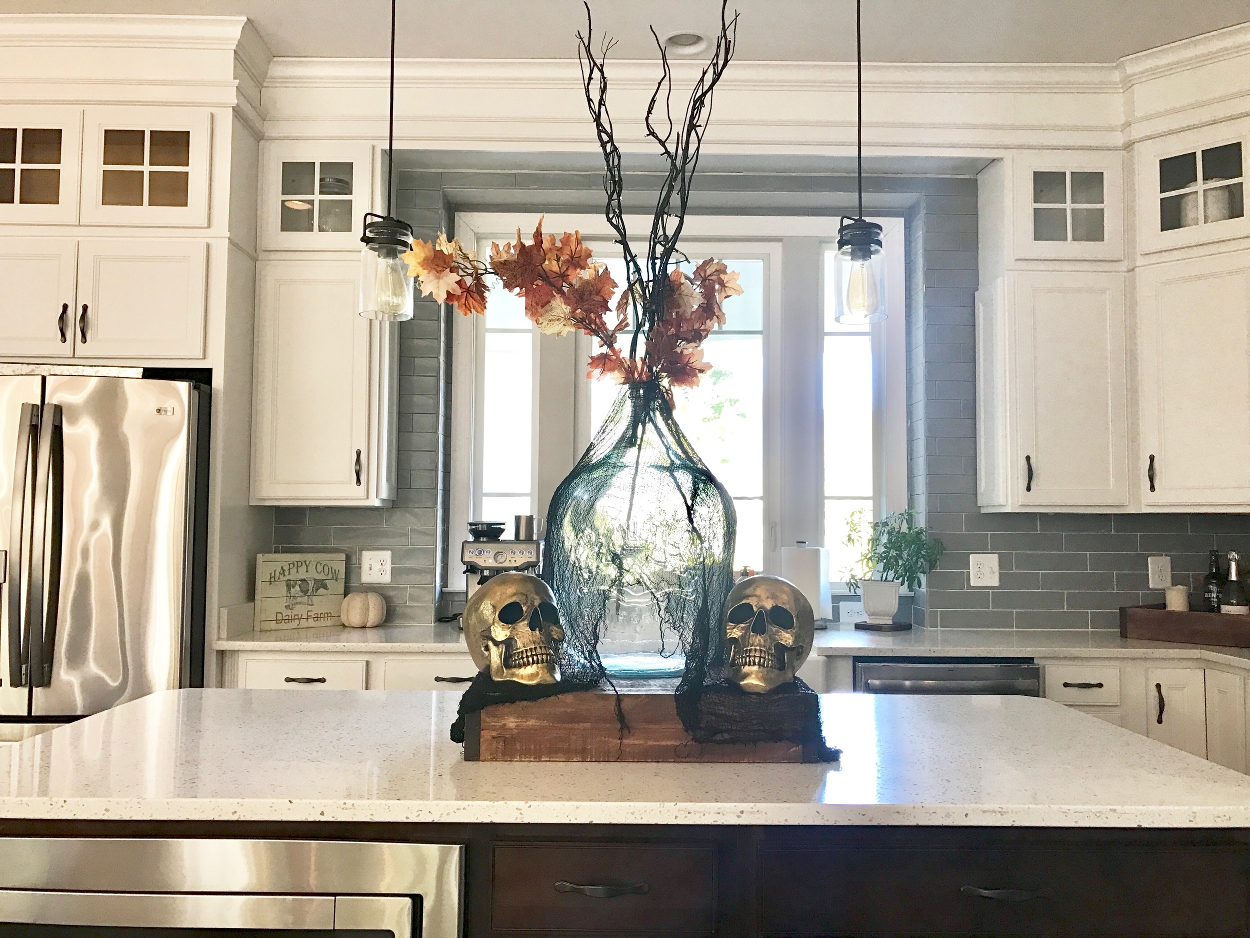 halloween-kitchen-skulls-gold-tablescape-spooky.jpg