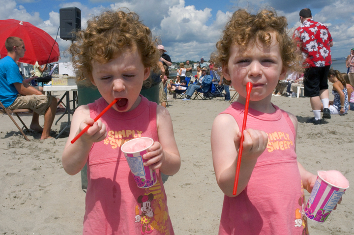 Twin sisters enjoying Italian Ice at a beach party in Winthrop, MA.
