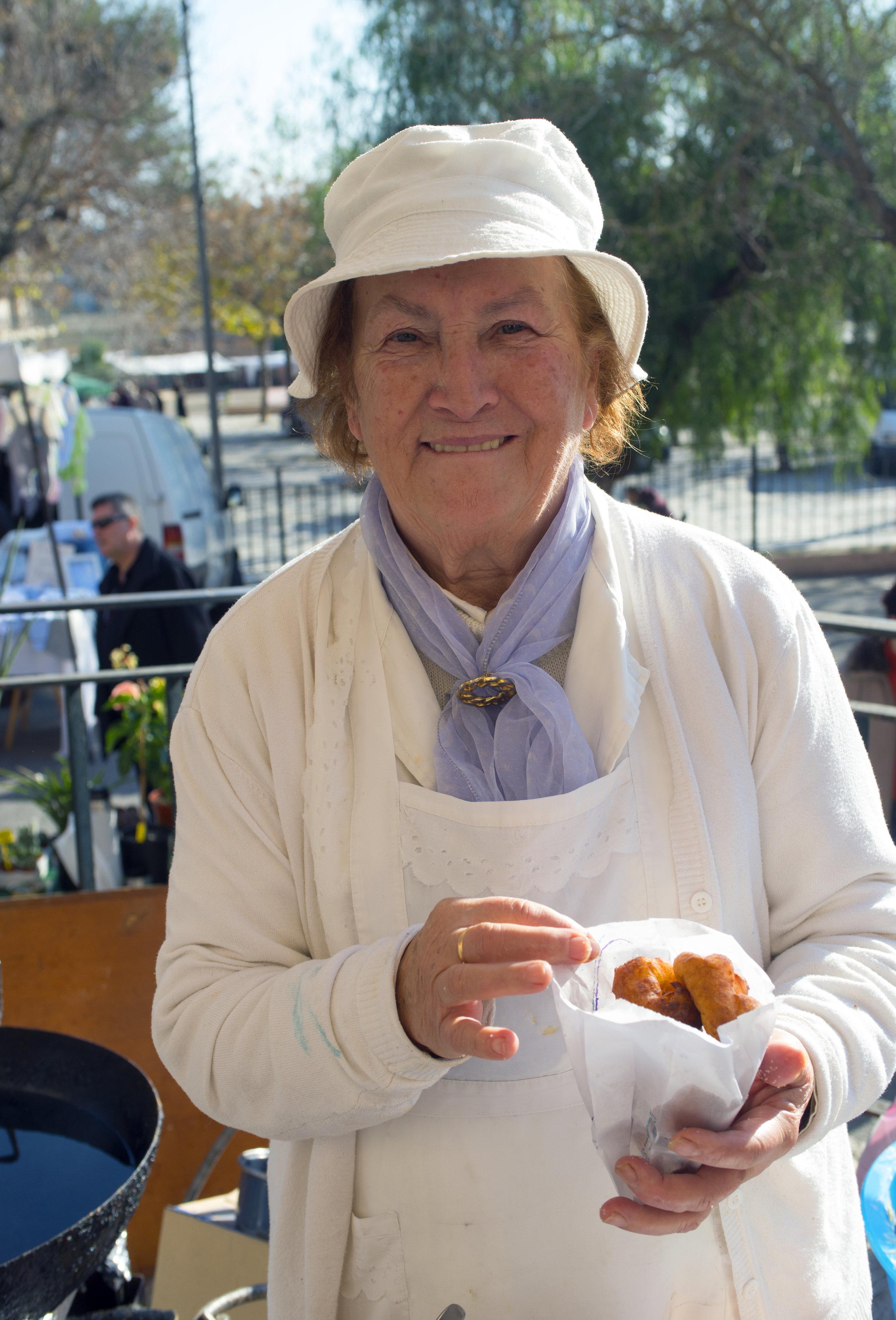 Warm donuts at the Sineu market, Mallorca Spain.