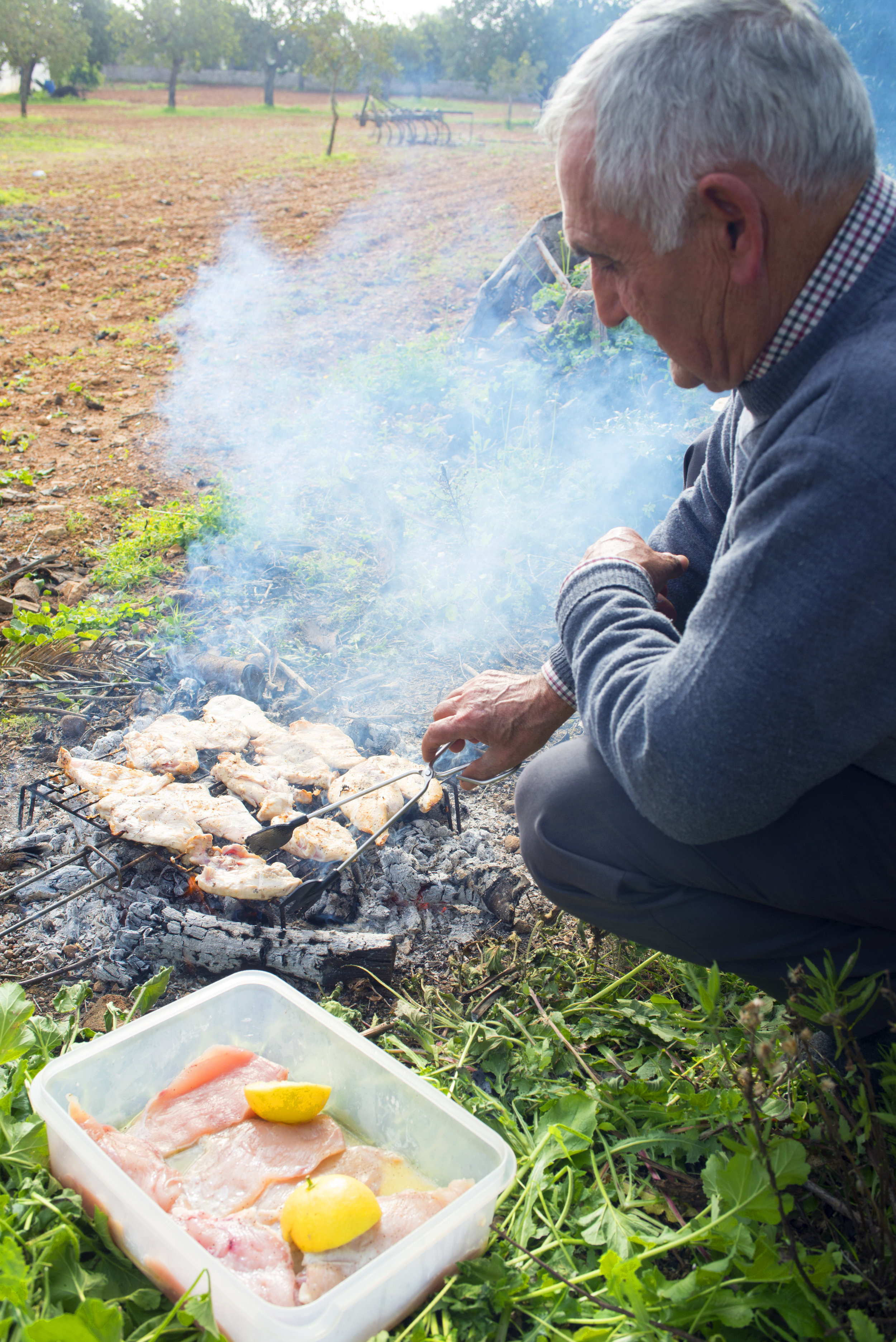 Grilling chicken Mallorcan style. Porreres, Mallorca Spain.