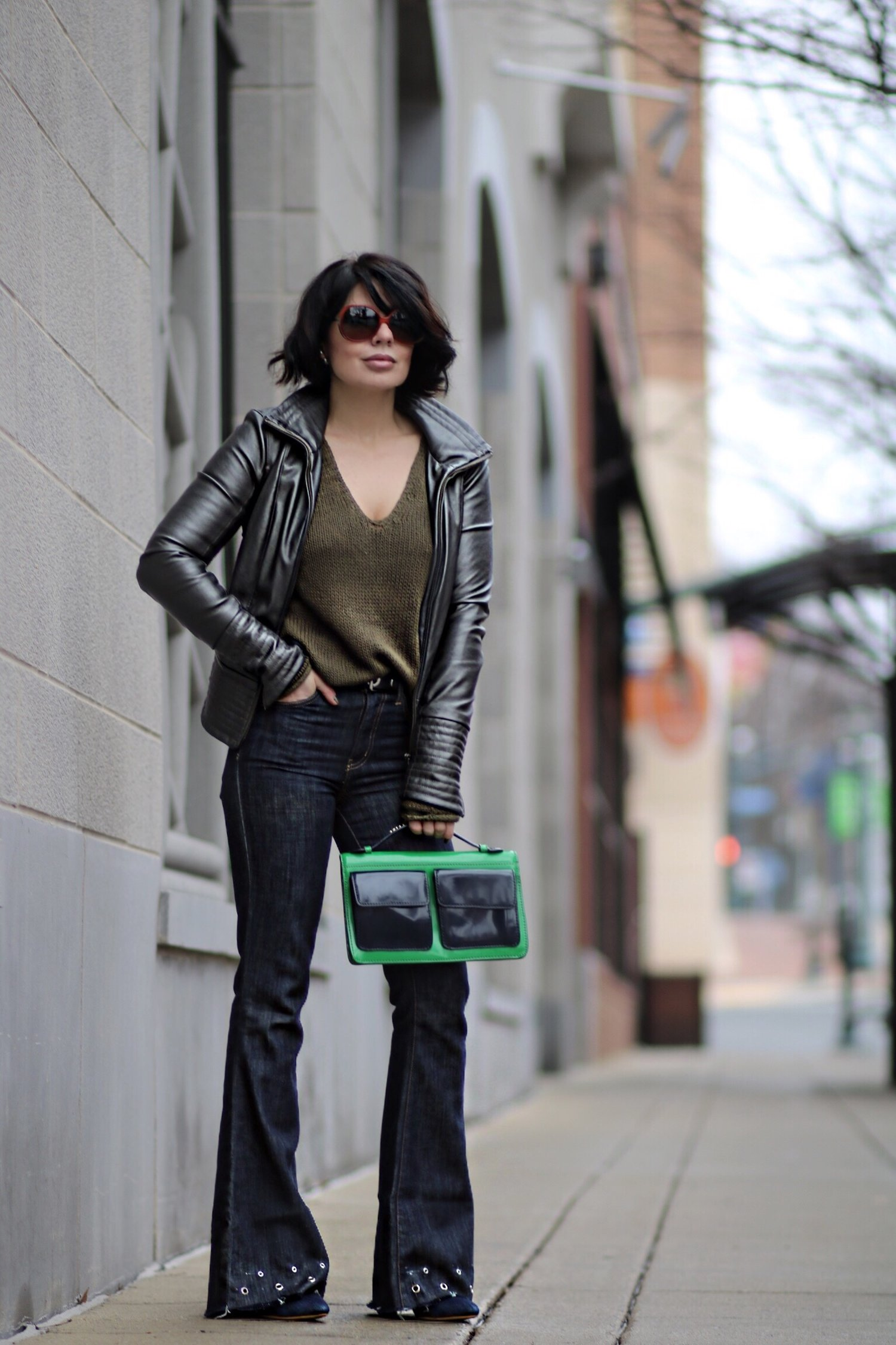 Style a leather jacket with grommet denim