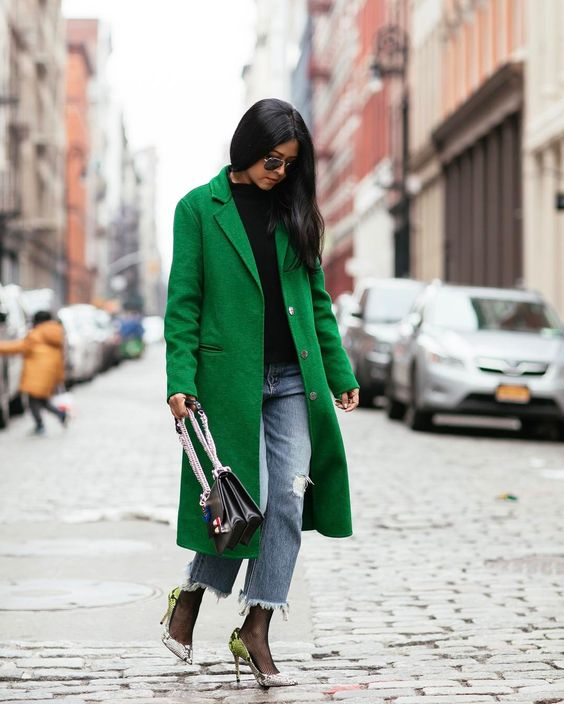 Sheryl Luke wearign a green coat