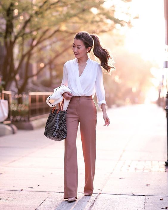 blogger wearing blush pants