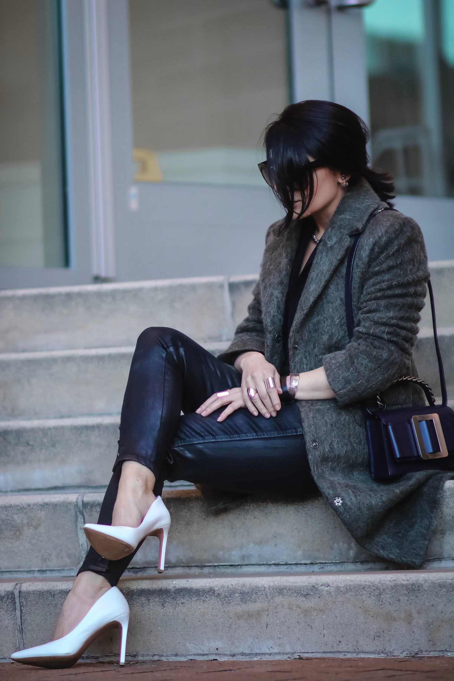 Isabel-Alexander-Wearing-Asos-khaki-textured-coat-sitting-down