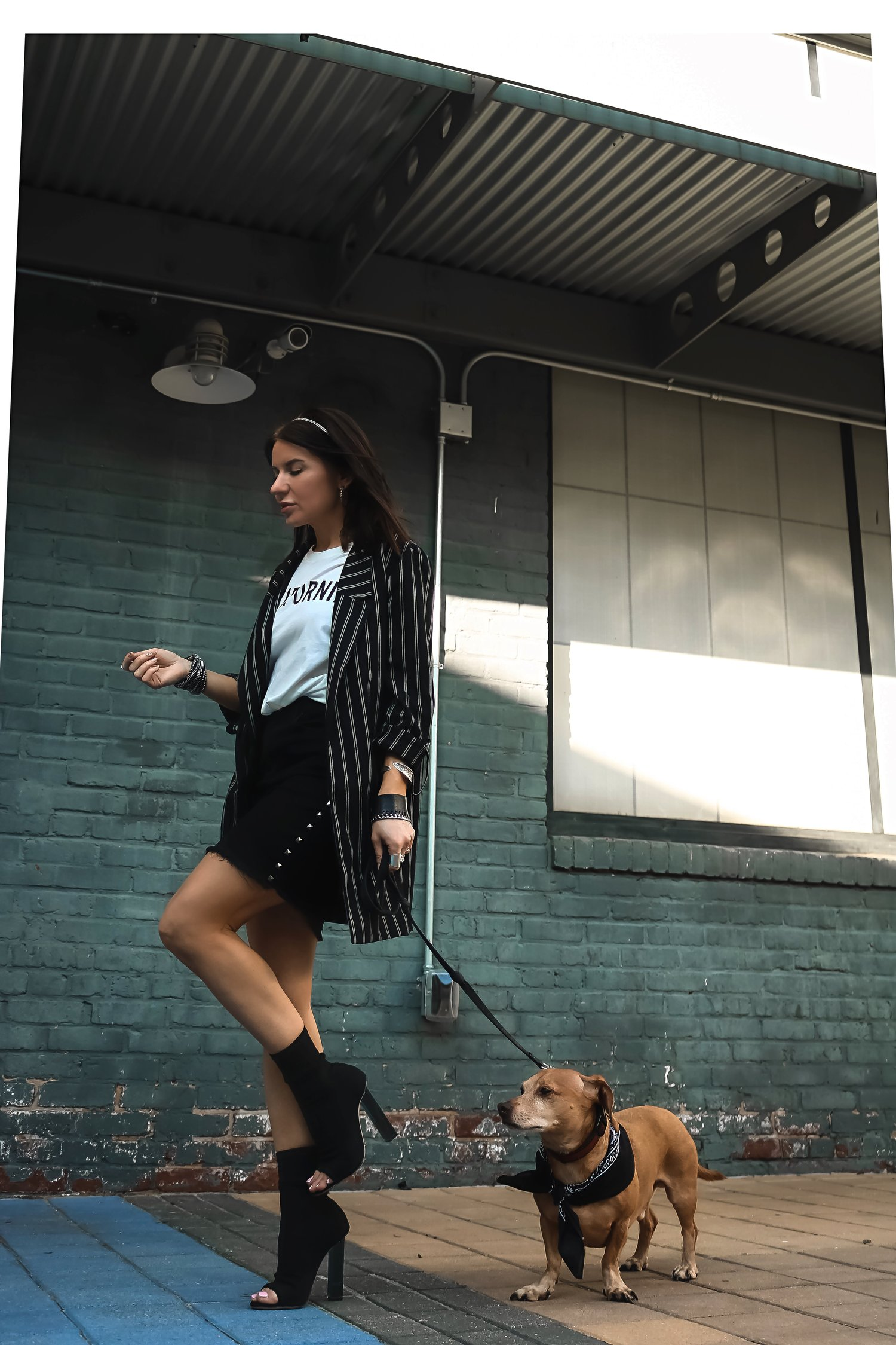 Isabel Alexander With Her Daschund Dog Wearing Boyfriend Blazer and Frayed Denim Skirt Street Style