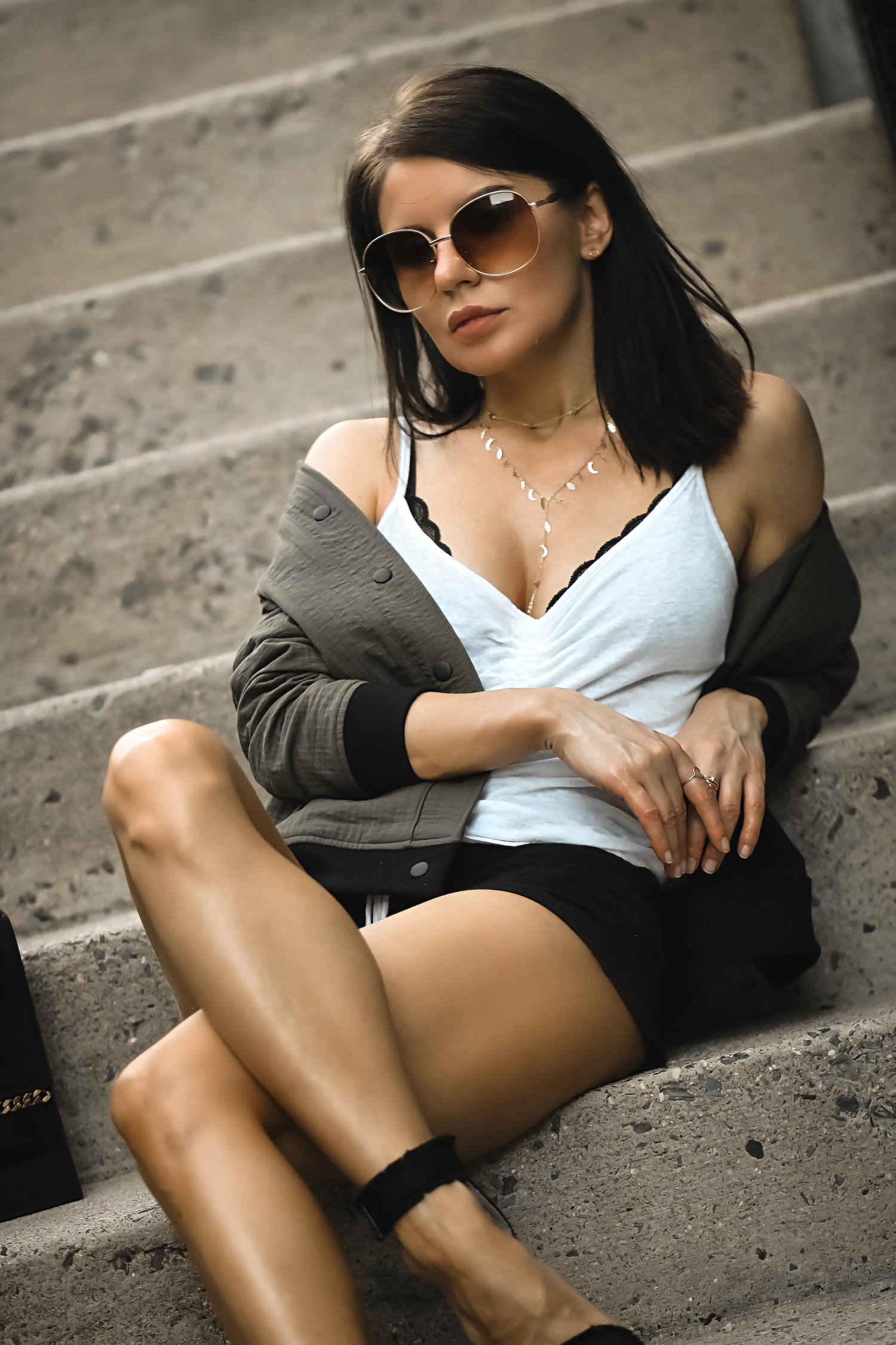 Isabel Alexander Wearing Adinas Jewels Lariat Necklace Sitting Down Stairs