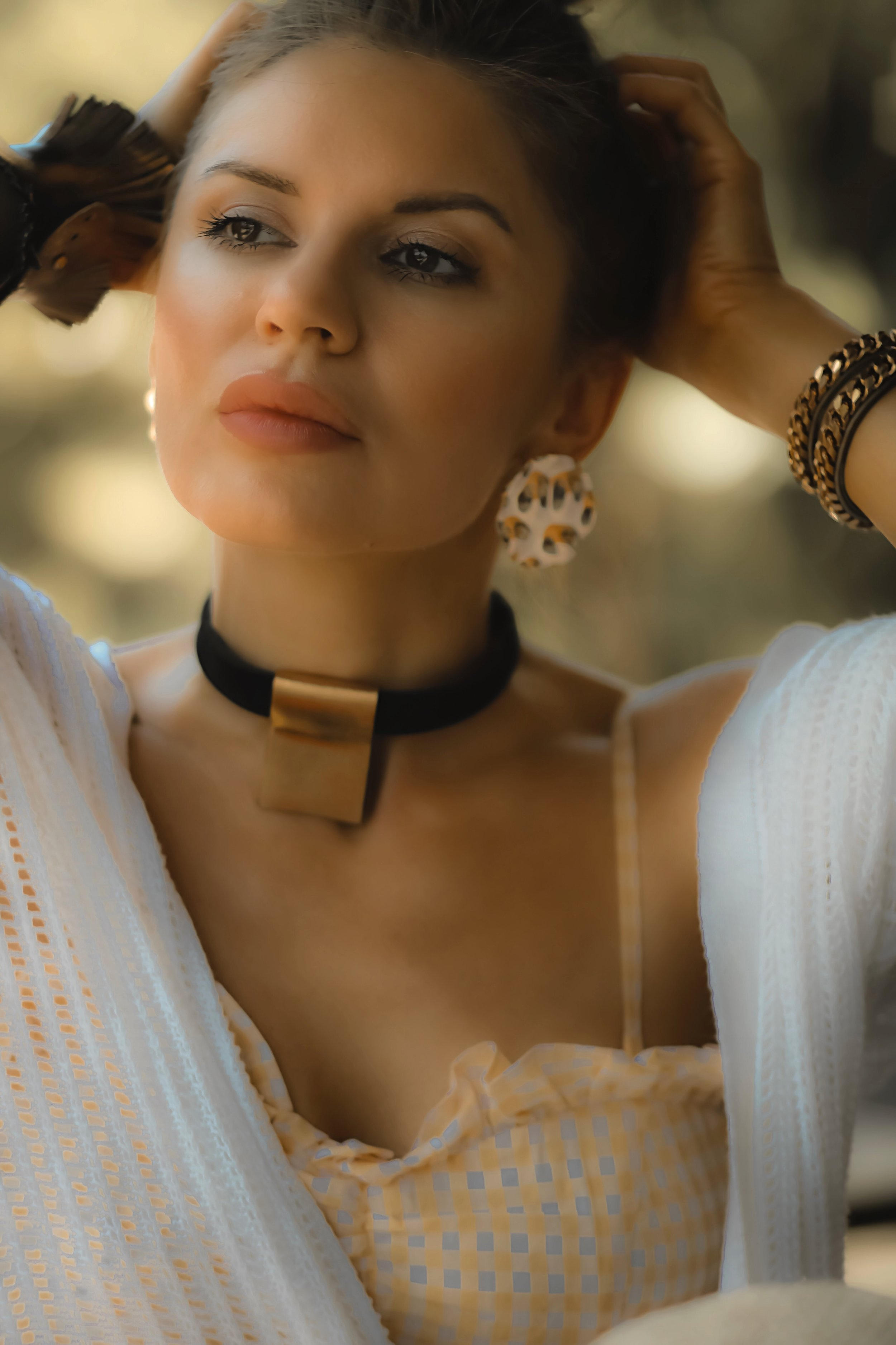 Isabel Alexander wearing a gold leather choker