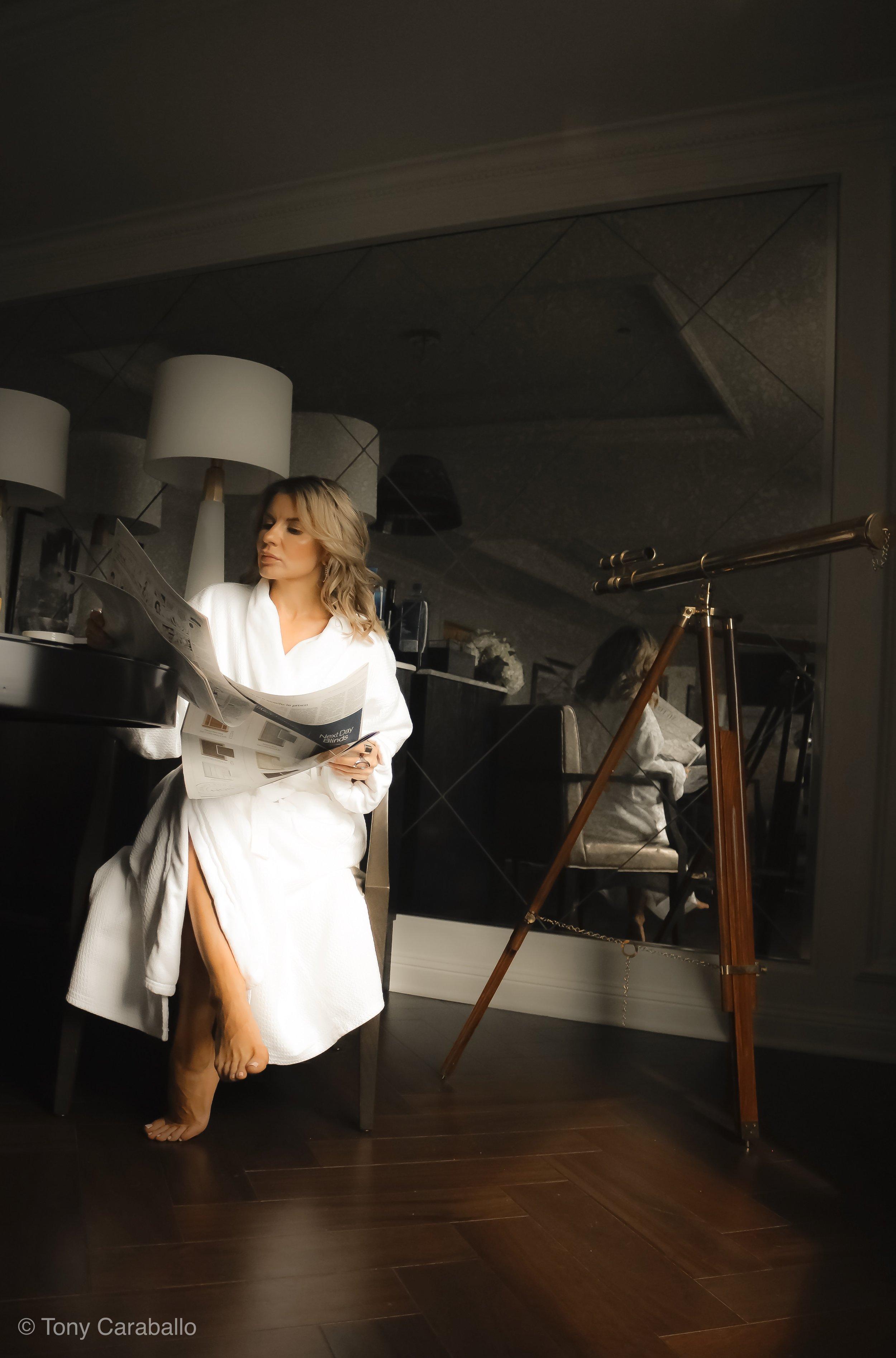 Ritz Carlton Presidential Suite Isabel Alexander reading morning newspaper