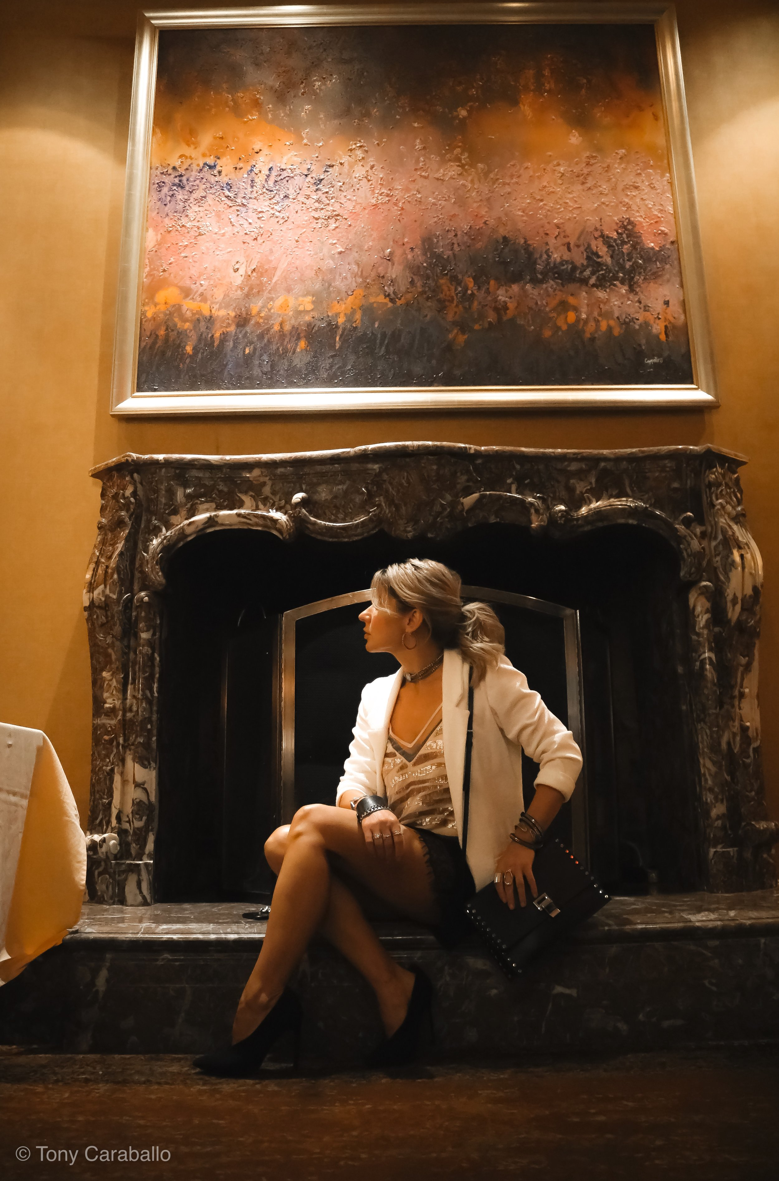 Ritz Carlton Isabel Alexander sitting down in the Lobby next to fireplace