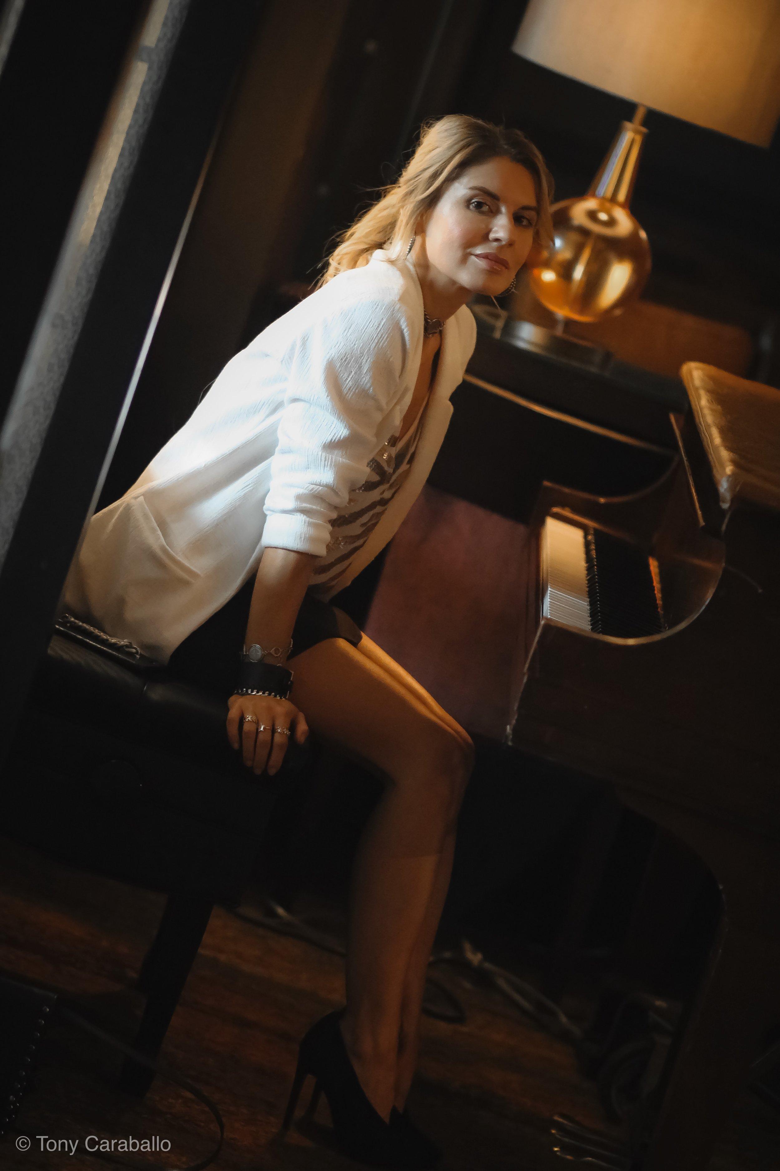 Ritz Carlton  Tysons Corner Isabel Alexander sitting at the piano