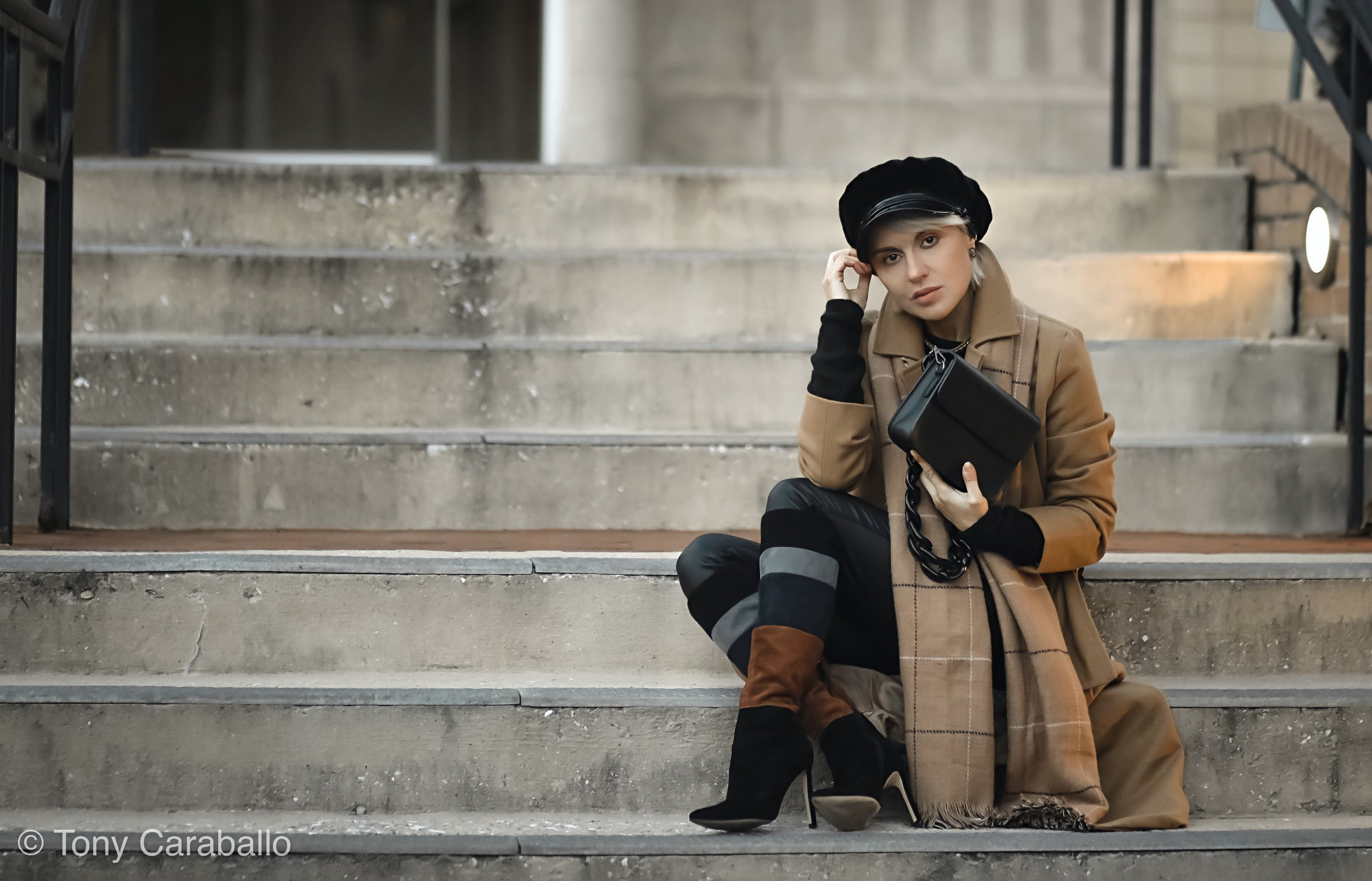 Isabel Chriselle Lim Tan coat sitting down