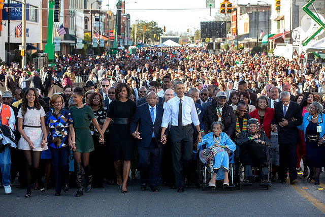 President Obama and Rep. John Lewis celebrate the anniversary of the Selma march on March 7, 2015.