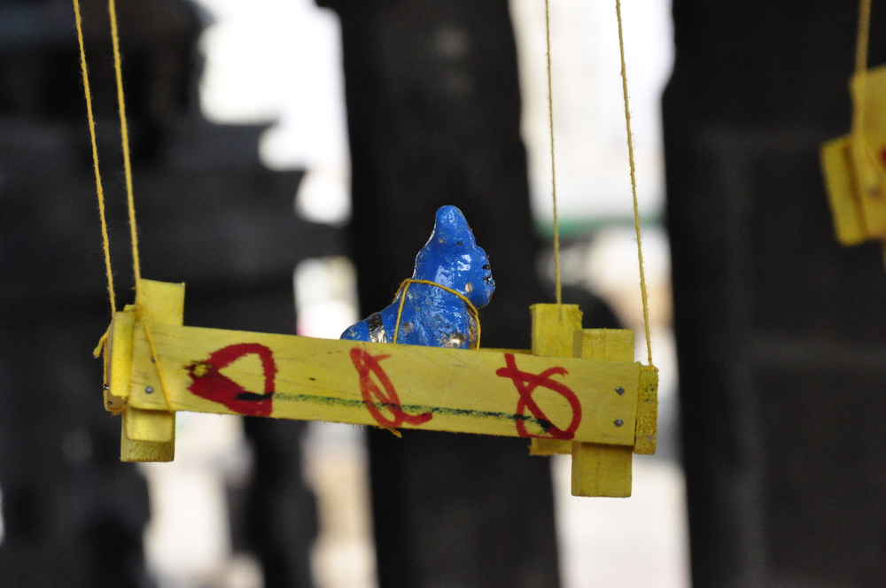 .. a cradle with a toy tied to a wishing tree
