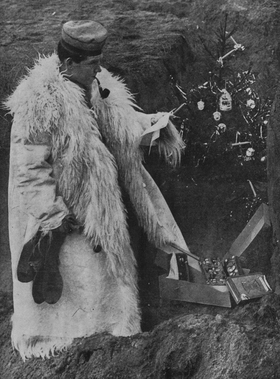 German soldier celebratingChristmas in the trenches, 1914.