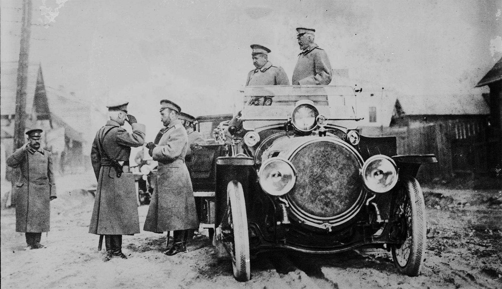 Tsar Nicholas II (third from left)visits the front, while his cousin, the army's commander-in-chief Grand Duke Nicholas, looks on (far right).