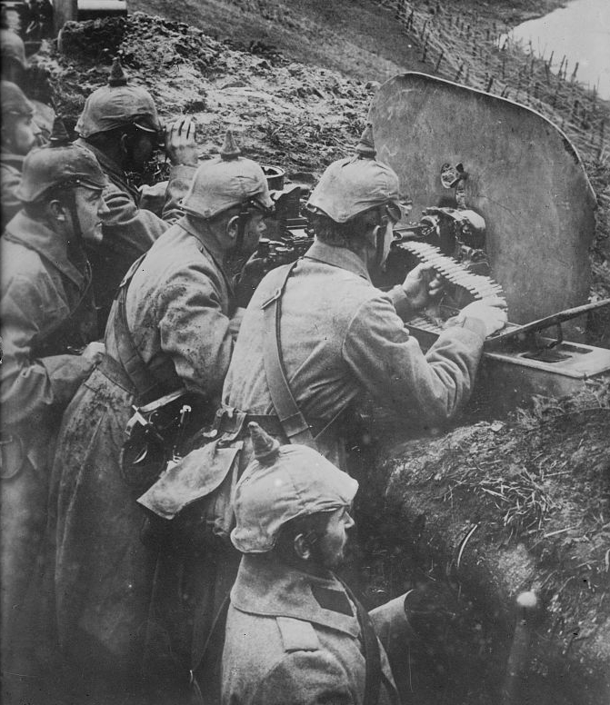 German machinegun on the Eastern Front, protected by trench and dense bands of barbed wire. Attacks on such positions invariably resulted in heavy losses among the attacking force.