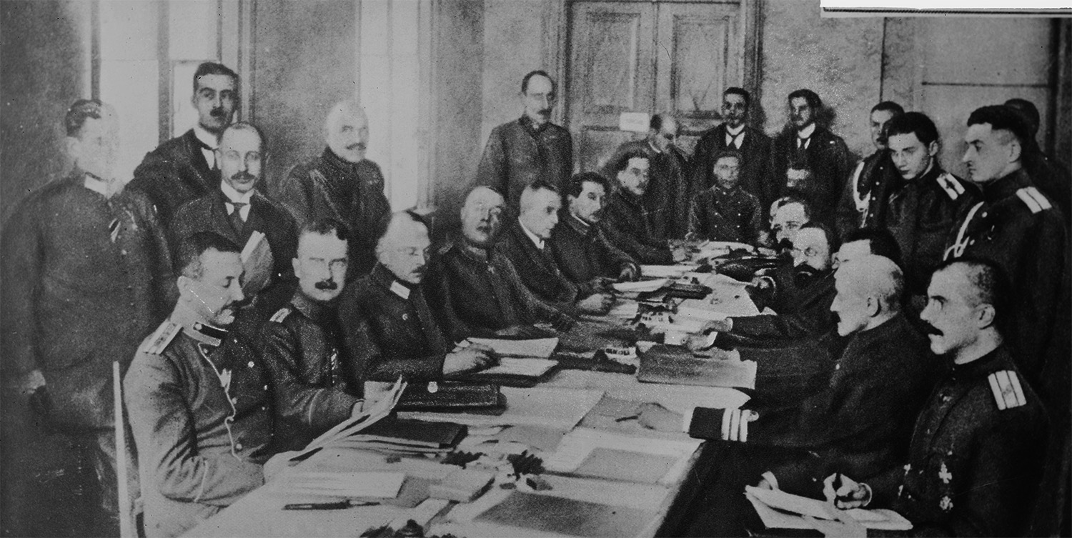 The German and Russian delegations meet at Brest-Litovsk to conclude a treaty that will end the fighting on the Eastern Front.