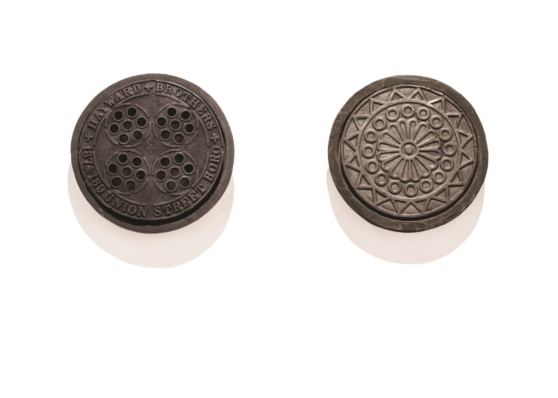 Commemorate SW19, 2012 & Commemorate SE1, 2013 Coal hole covers cast in compressed charcoal dust