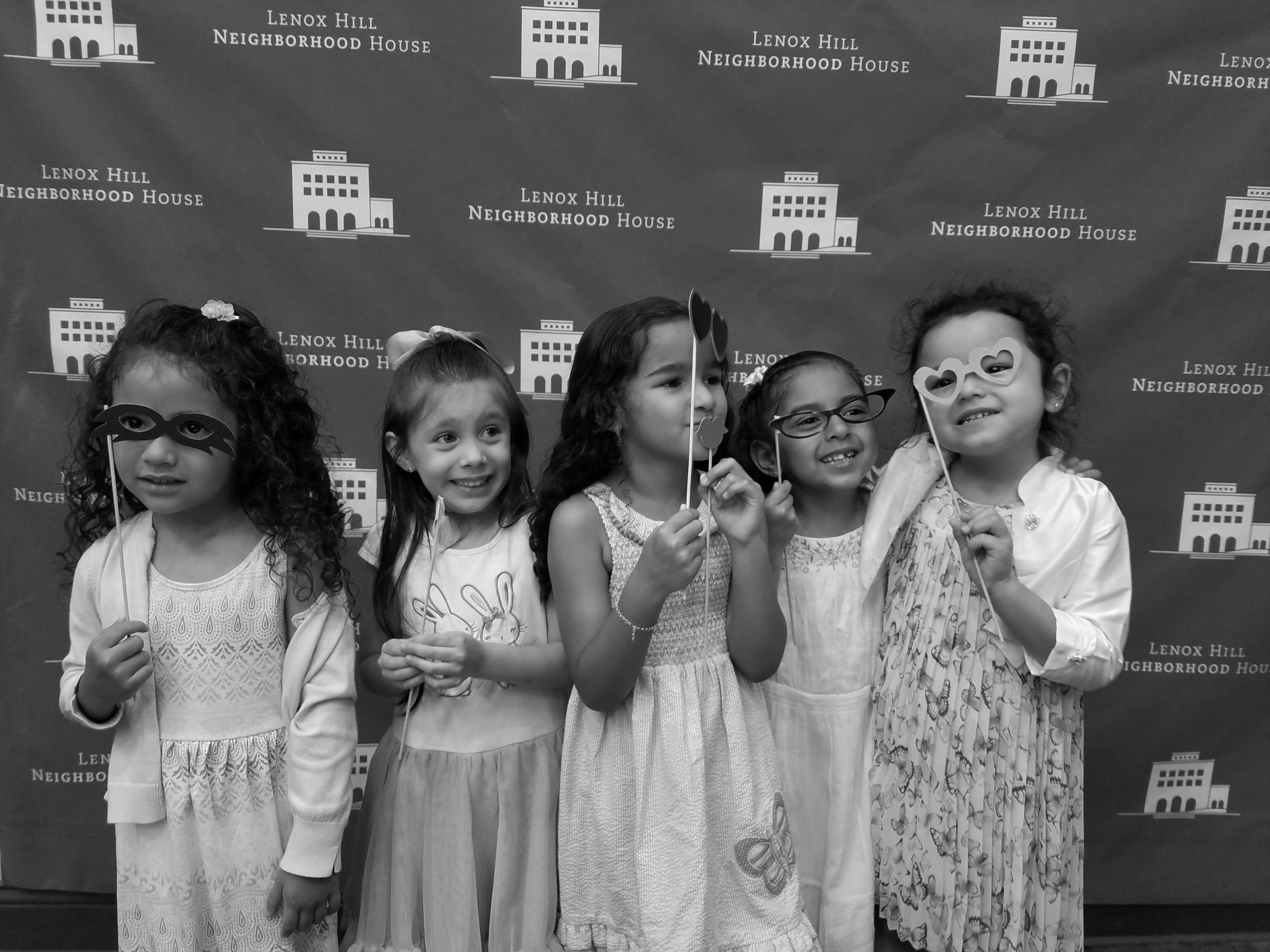 Group of Five Girls in Front of Neighborhood House Step and Repeat