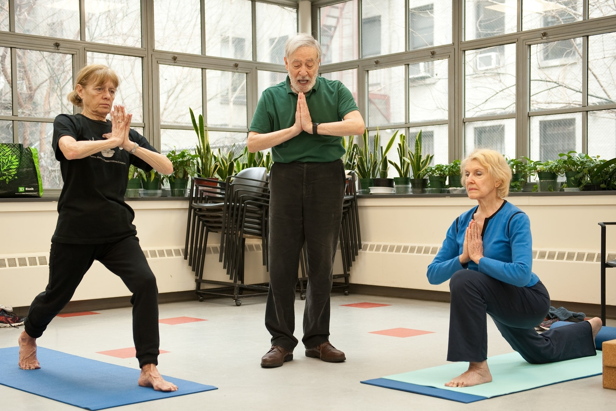 Three Adults Doing Yoga