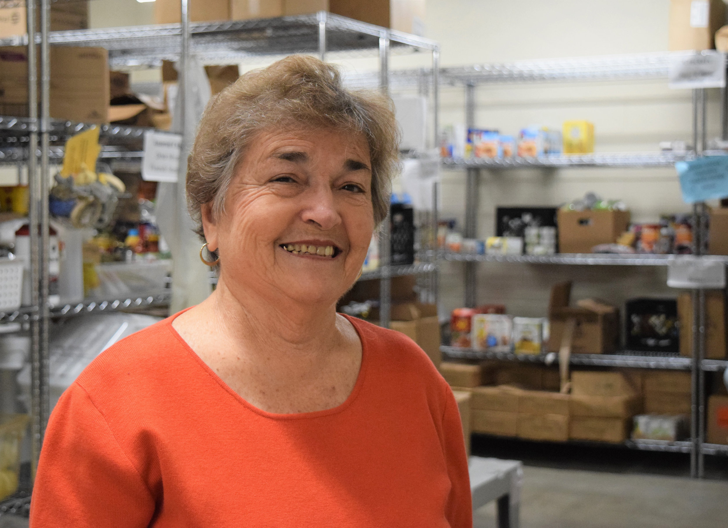 Carol stands in the MwC Kitchen Pantry. Photo courtesy of  UWBCKR .