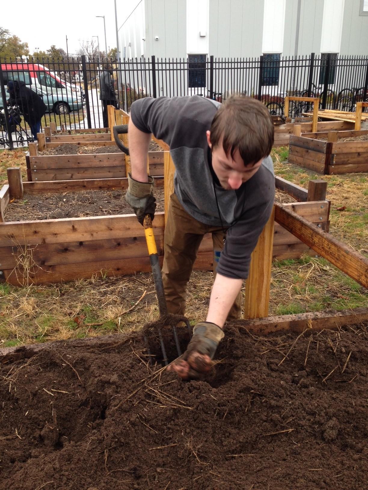 johnny digging potatoes.jpg