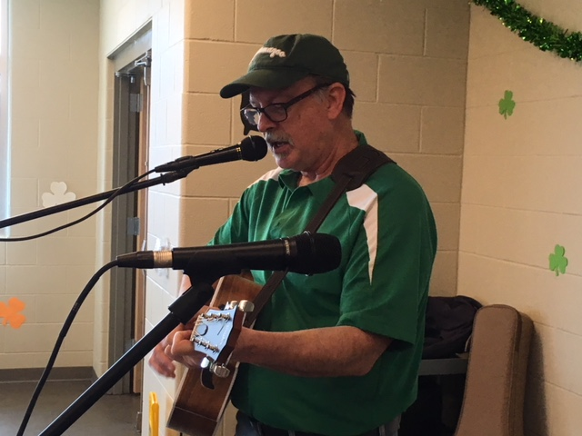 Volunteer Bob DeShazo plays the guitar during a meal sponsored by the Irish American Club last St. Patrick's Day.