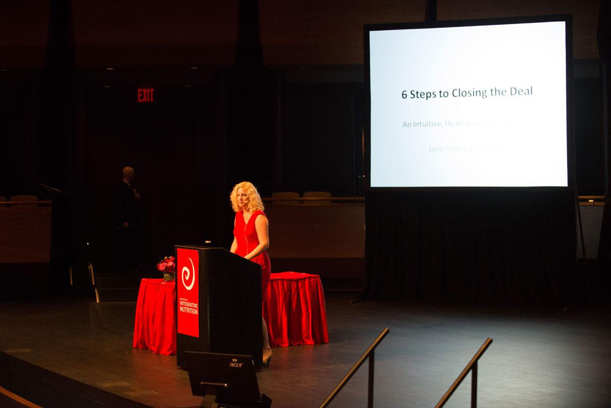 "Jane speaking on stage at the Institute for Integrative Nutrition annual Conference at Lincoln Center, NYC. ""6 Steps to Closing the Deal: A Heart-centered Approach to Sales"""