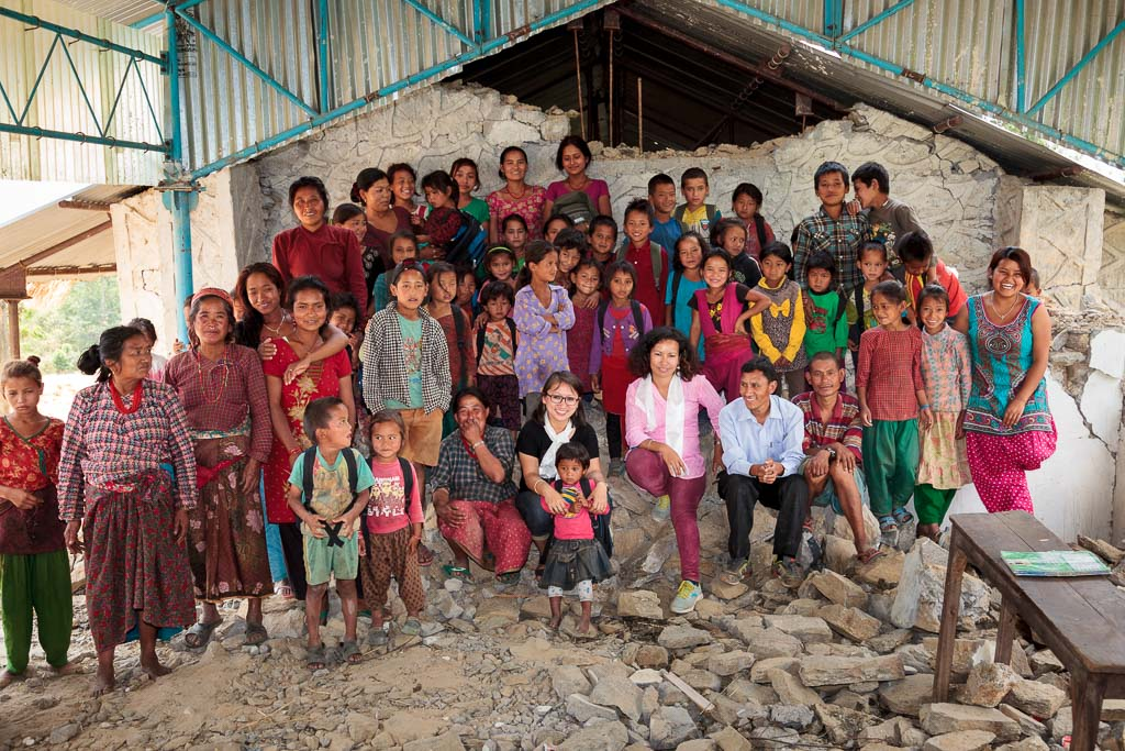 Group photograph of Rewati Gurung, Menuka, the principle of Shree Salme Primary School, Sun Bar Tamang and the pupils in the remains of the school.