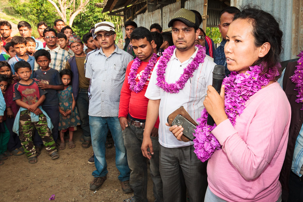 Rewati Gurung speaks to the children and their parents about the importance of being able to continue their education.