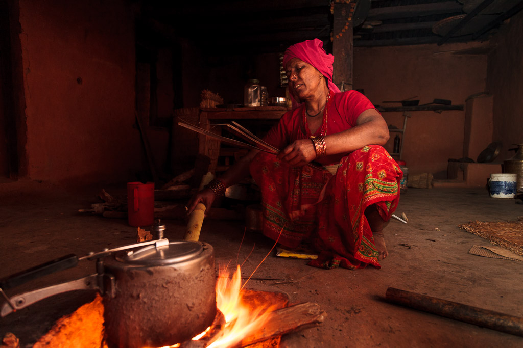 In the evening we eat traditional Nepali food in a traditional mud floored home - the childhood home of our host - the stationer from Kathmandu.