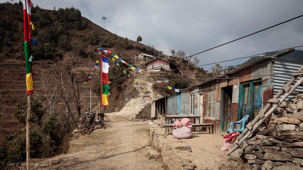 A view of the village with the new school house perched on the side of the hill.