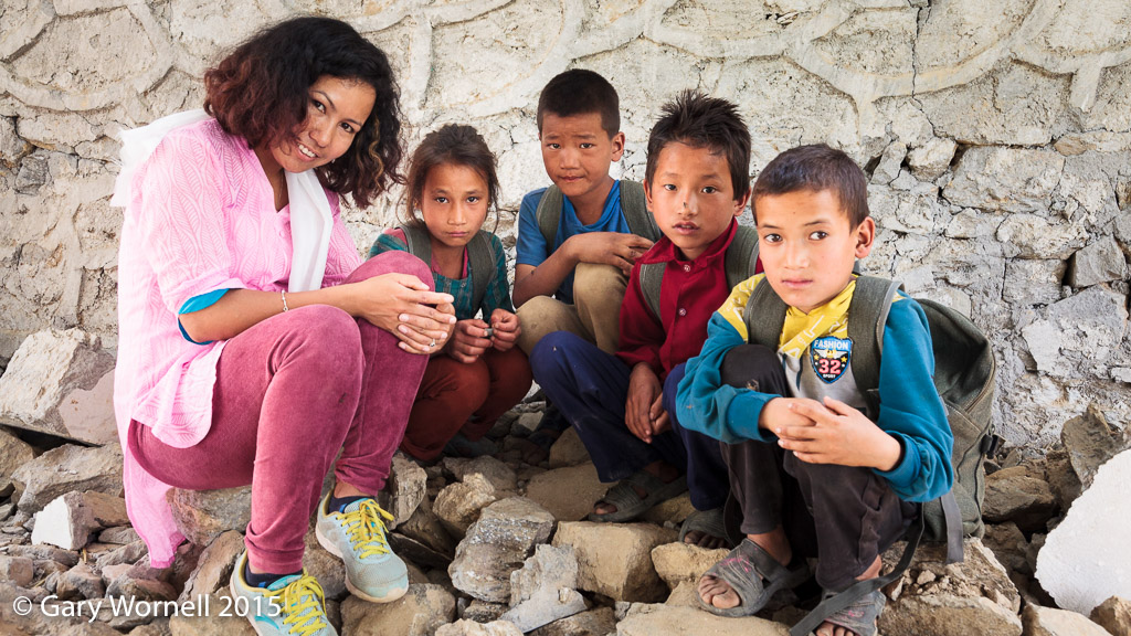 Some of the children from Shree Salme primary school during donation day in 2015. The boy on the right poses with Rewati Gurung in the photo below.