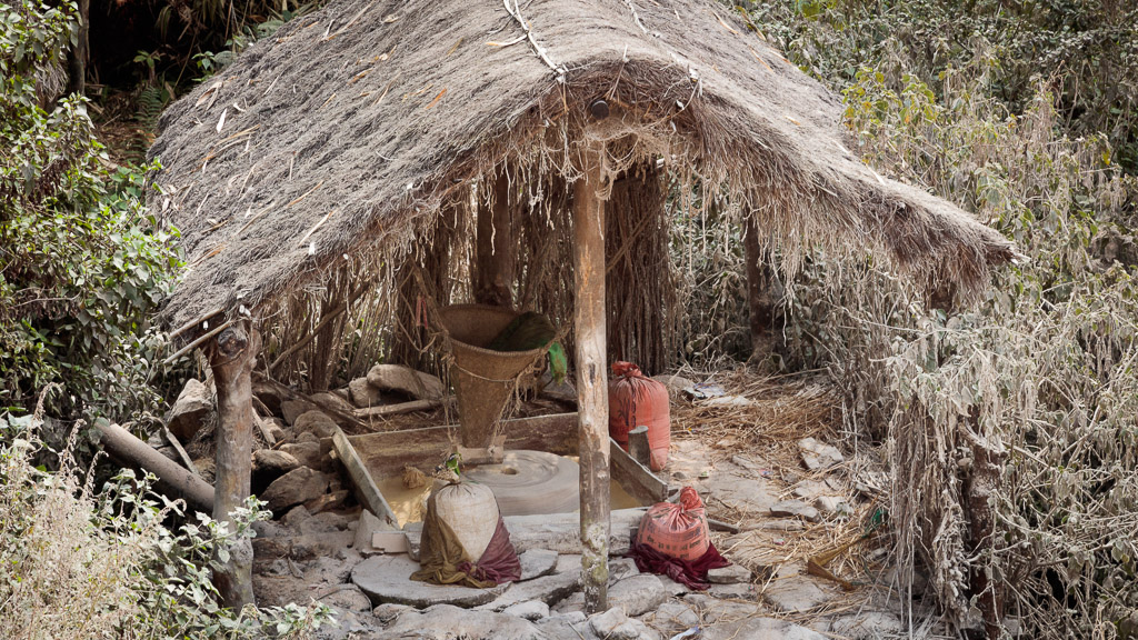 The water mill, grinding corn and rice flour.