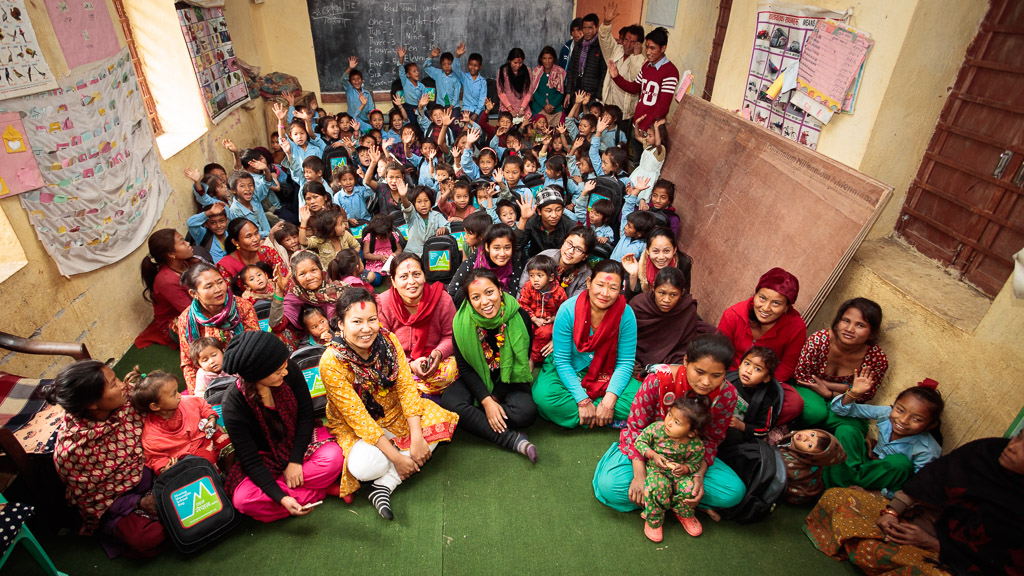 Children, teachers, parents and volunteers from Moving Mountain Nepal and Unatti Group Home for Girls pose for a group photo on donation day - February 1st, 2018