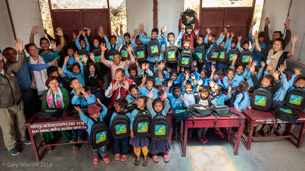 Children from Shree Tarevire Primary School gather for the group photo in their new classroom.