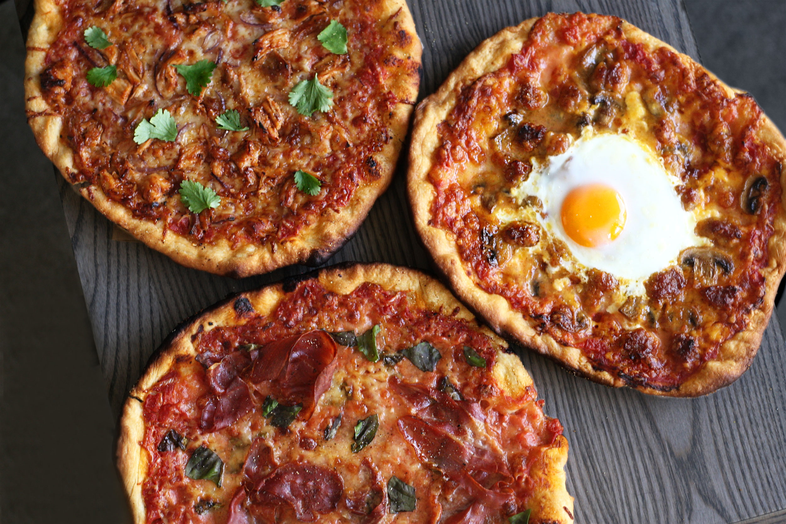 BBQ chicken pizza, prosciutto pizza & breakfast pizza