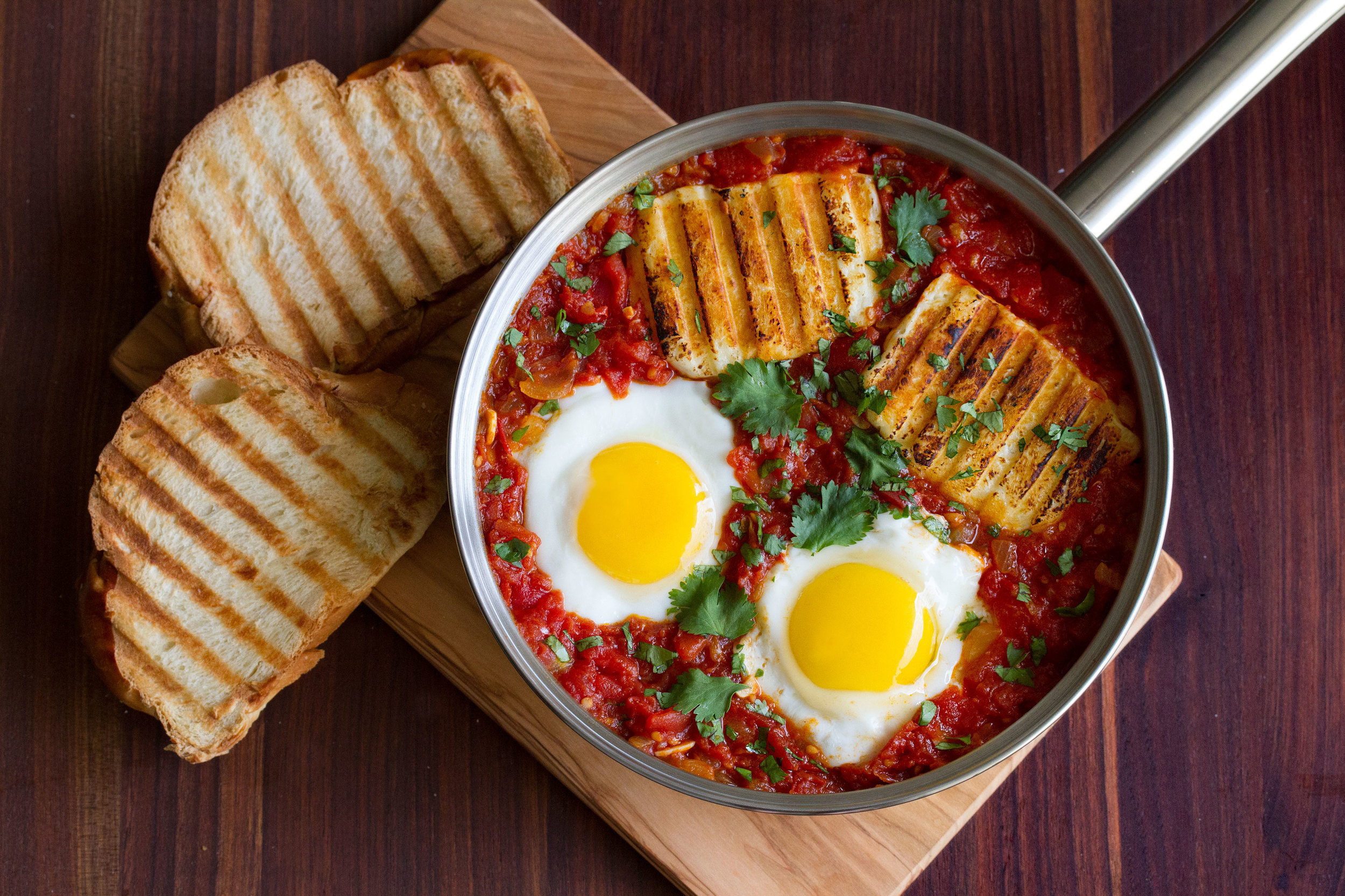 Spicy Baked Eggs with Halloumi Harissa