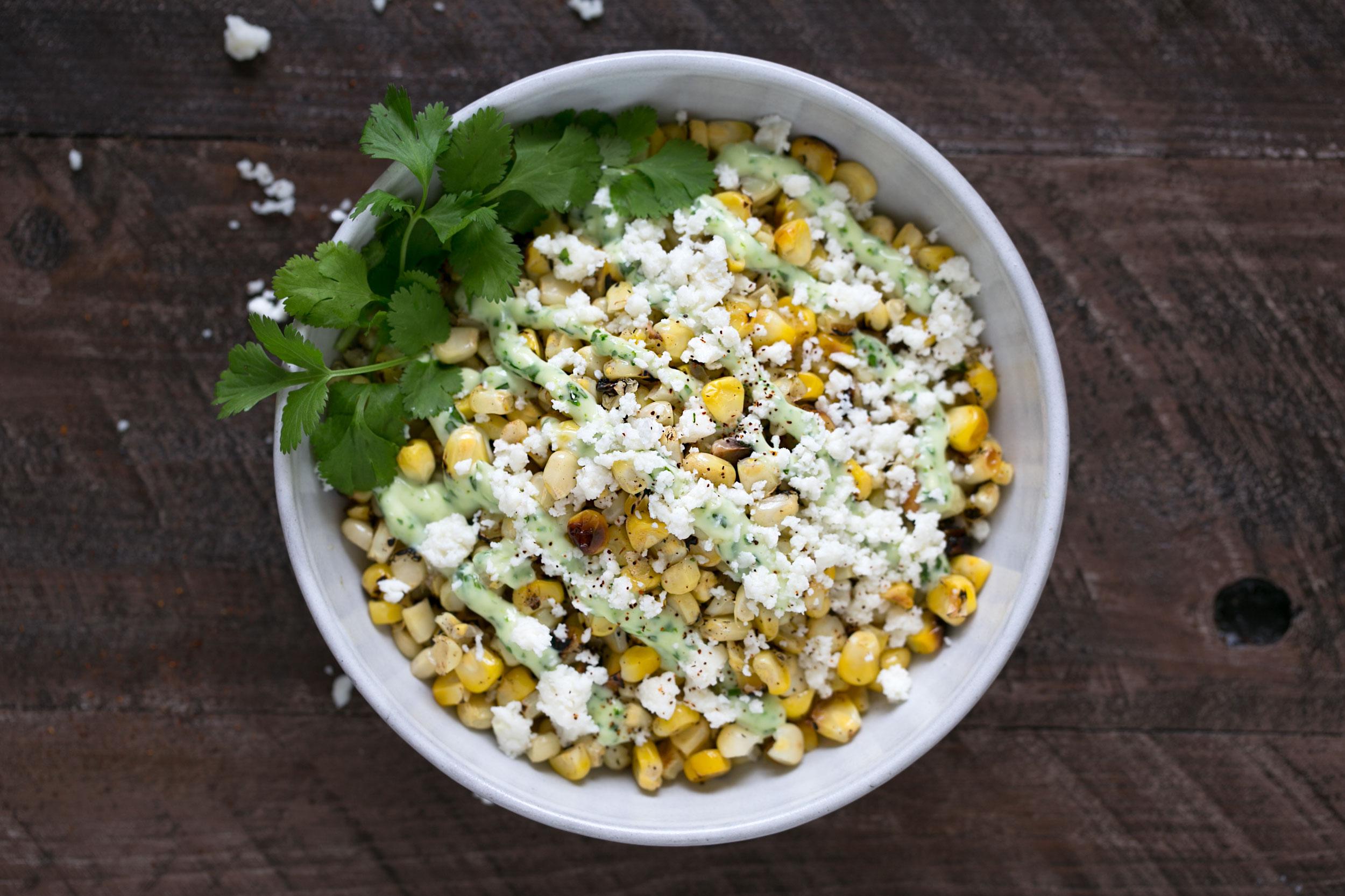 charred corn with cilantro aioli and queso fresco bowl