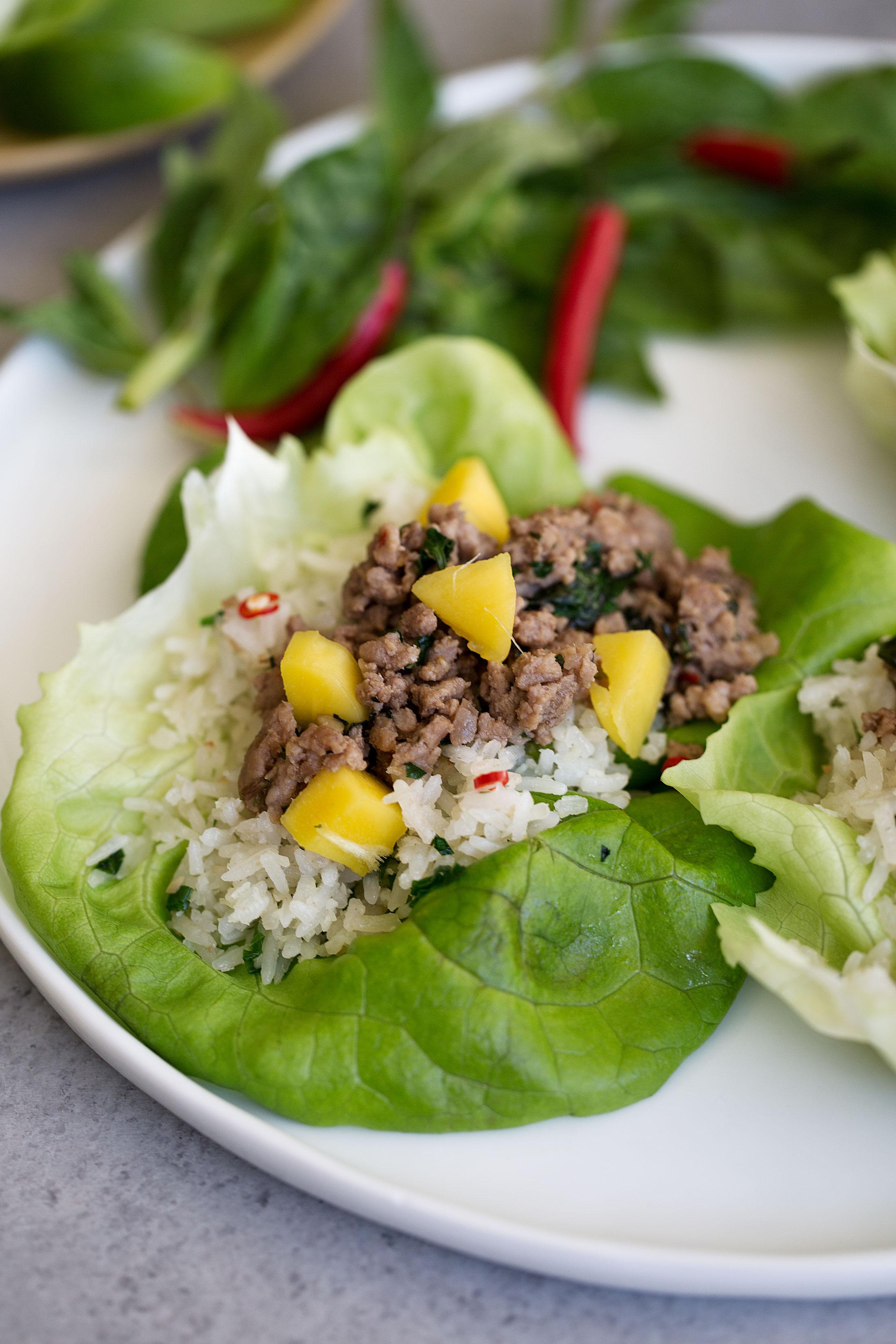 thai pork lettuce wraps with coconut fried rice closeup